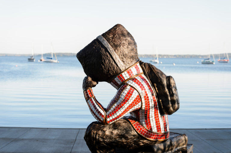 """Well Red,"" a sculpture by artist Douwe Blumberg of a studious-looking UW-Madison mascot Bucky Badger sitting atop a pile of books, looks out on Lake Mendota from Alumni Park at the University of Wisconsin-Madison during the autumn morning of Oct. 8, 2017. The newly-opened park, part of the Wisconsin Alumni Association (WAA), is located between the Memorial Union and Red Gym (Armory and Gymnasium) overlooking the shoreline."